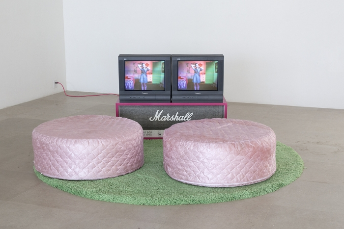 Sue de Beer Disappear Here, 2004 2-channel video installation with 2 DVDs, DVD synchronizer, 2 beanbag chairs, wood, silkscreen, shag pile rug 96 x 96 inches (243.8 x 243.8 cm), 5 mins.