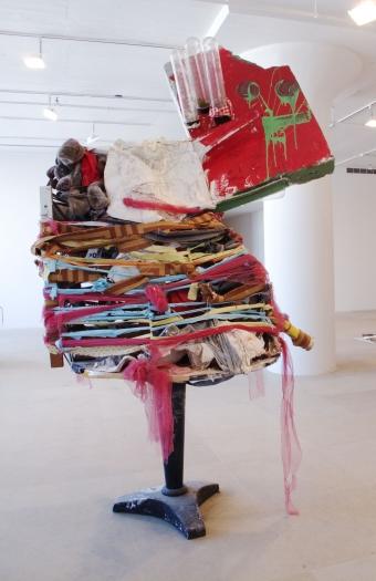 Untitled, 2010, mixed media, 96 x 95 x 59 inches, Installation view, Greene Naftali, New York, 2010