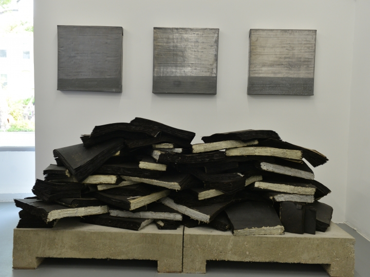 TRAVIS J. WAGNER Ta Biblia installation view 2014, tar paper, twine, adhesive, concrete and steel, 33 x 88 x 40 inches.
