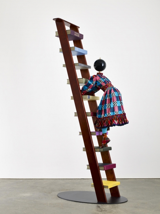 , YINKA SHONIBARE, MBEMagic Ladder Kid IV,2014Mannequin, Dutch wax printed cotton textile, leather, fiberglass, wooden ladder, steel baseplate, globe