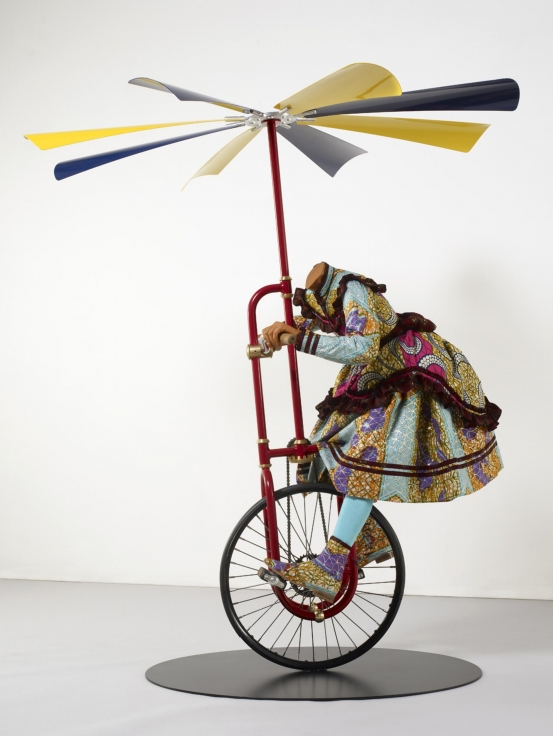 , YINKA SHONIBARE MBE Girl on Flying Machine, 2008 Mannequin, Dutch wax printed cotton, steel, rubber and aluminum Dimension variable