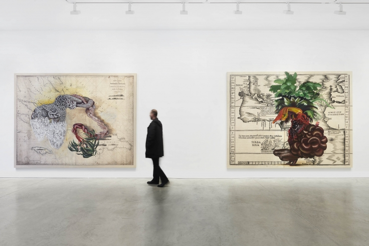 figure in front of two paintings