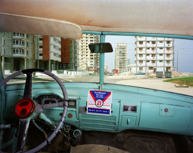 ALEX HARRIS  Primera between C and D, Vedado, looking west from Jorge Félix Gainza Duran's 1951 Plymouth, Havana May 25, 1998