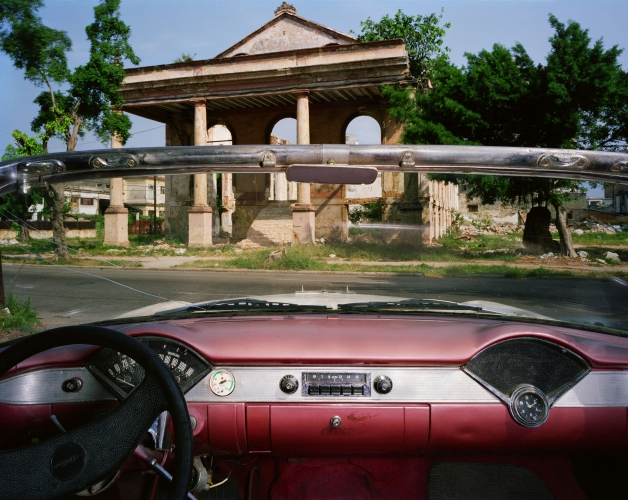 ALEX HARRIS  Ruins of the Troya Hotel, Paseo 405 between 17 and 19, Vedado, looking north from Jorge Chicola's 1956 Chevrolet Bel Air, Havana May 24, 1998