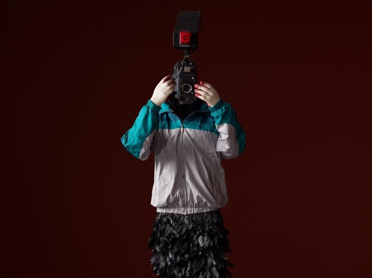 Minouk Lim (b. 1968) L'homme à la caméra, 2015 FRP mannequin, windbreaker, gloves, feathers, broadcast camera 88.58 x 26.77 x 22.83 inches 225 x 68 x 58 cm