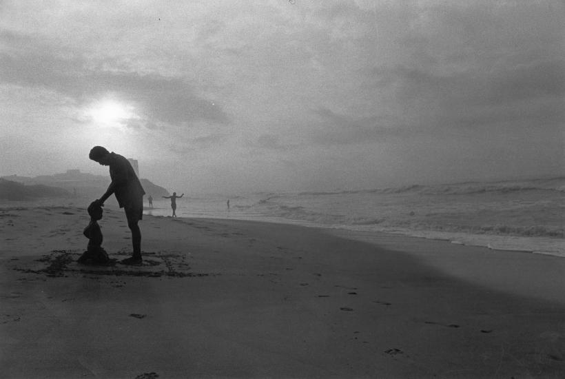 Chester Higgins - Father prays over son on Osu Beach, Accra, Ghana, 1973  | Bruce Silverstein Gallery