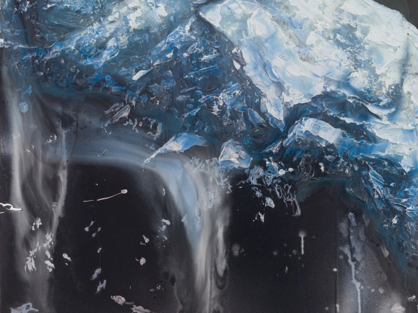 a massive glaciar calves as a kayaker paddles by