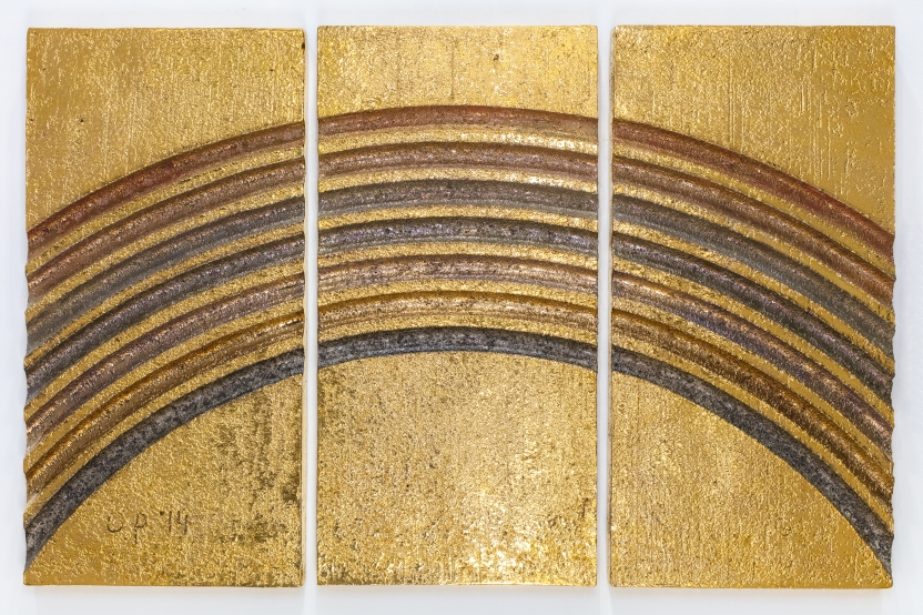 large ceramic triptych with a rainbow pattern in gold and and metallic glazes