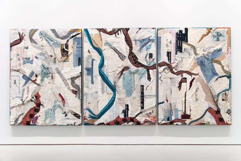 Abstract composition consisting of three parallel canvas panels featuring collaged textiles, paint, and cardboard.