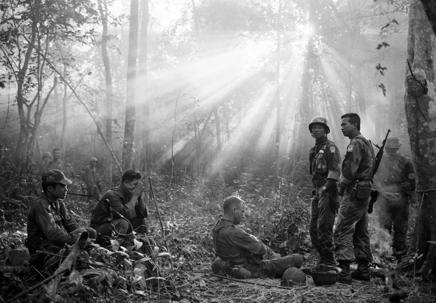 Horst Faas- Sunlight Breaks Through Dense Foliage Around the Town of Binh Gia as South Vietnamese Troops