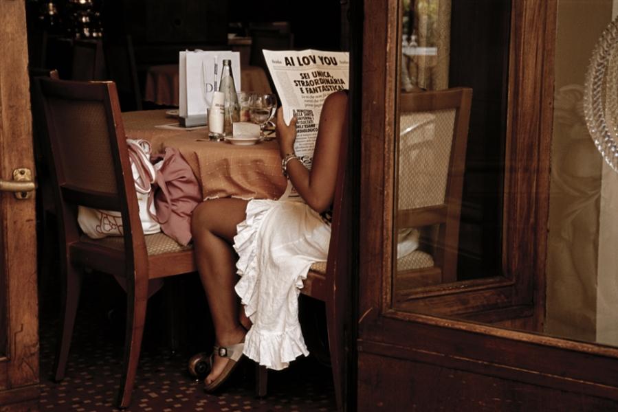 Jodi Cobb- Woman Reading a Greeting Card Designed as a Newspaper