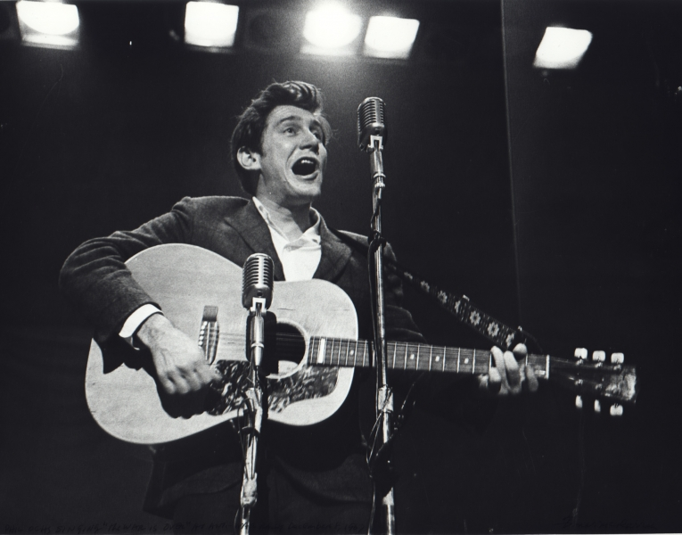"Fred W. McDarrah- Phil Ochs Singing ""The War is Over"""