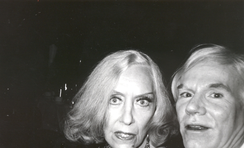 Bob Colacello - Gloria Swanson and Andy Warhol at a Cartier Part