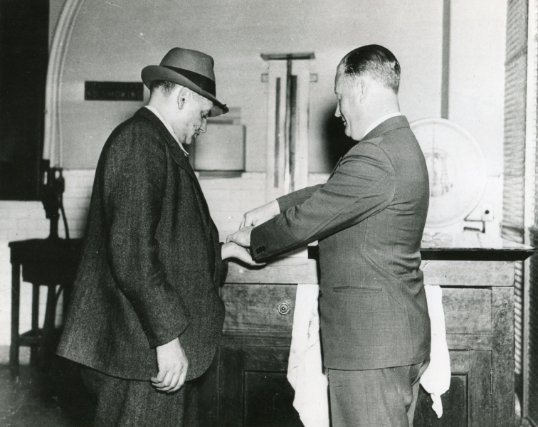 Weegee- Arthur Fellig Demonstrates How New York Police Operate