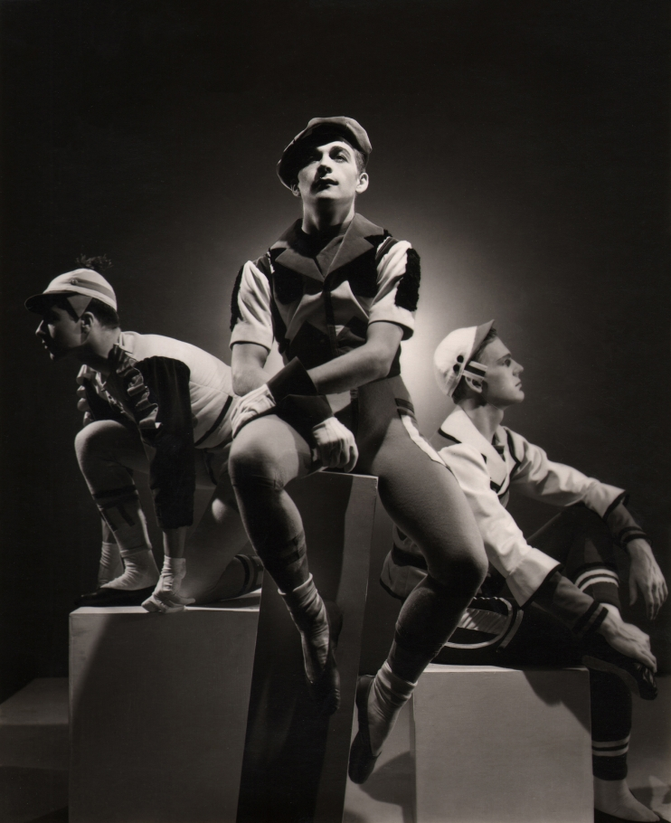 George Platt Lynes, Show Piece, The Ballet Caravan, 1937. Three male figures pose seated on blocks facing left, forward, and right.
