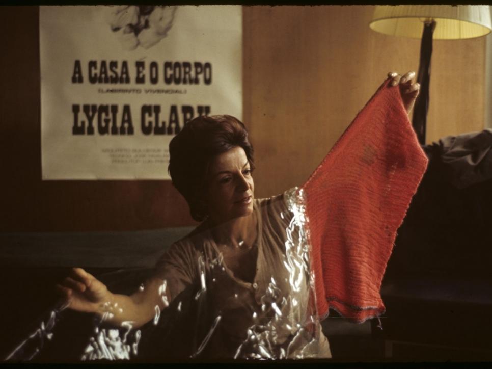 woman holding red cloth and plastic sheet