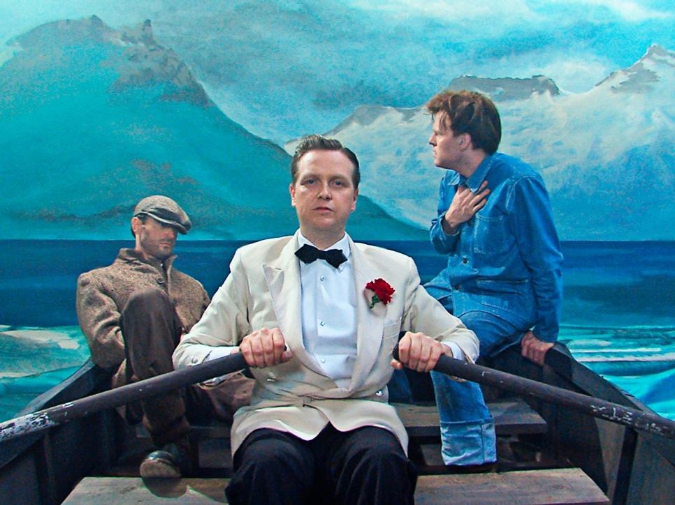 3 men in rowboat