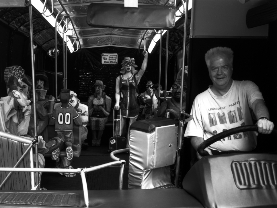 Black and white photographic portrait of Red Grooms on The Bus, 1995