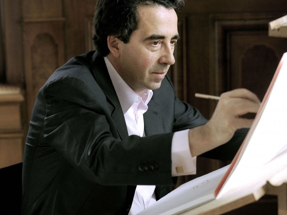 Color photographic portrait of Santiago Calatrava sketching