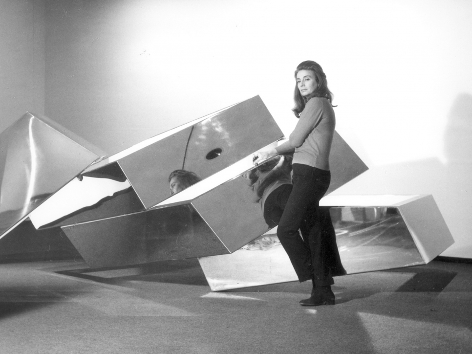 Portrait of Beverly Pepper with her work, Fallen Sky, 1968
