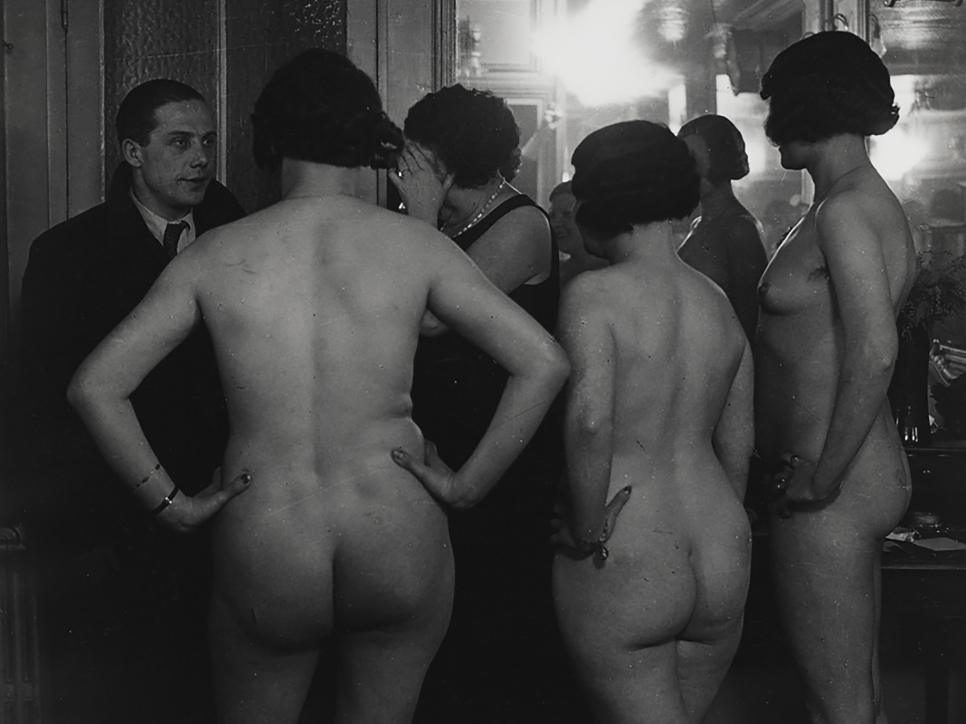 Black and white photography by Brassaï featuring the behind view of nude women standing