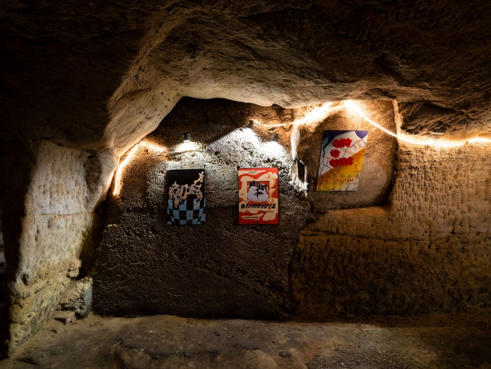 Katz poster installation in cave