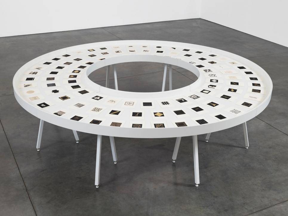 Zarina woodcuts displayed on circular table