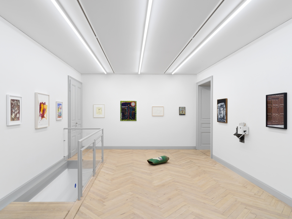 Installation view of group painting, photography, and sculpture exhibition
