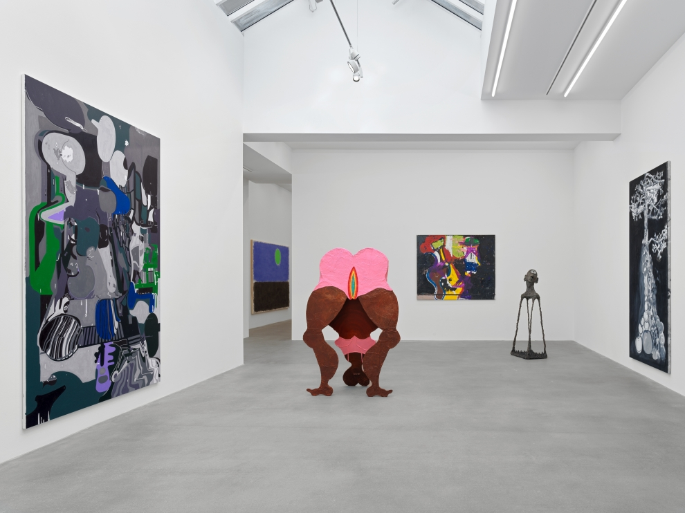 Installation view of group painting, print, and sculpture exhibition