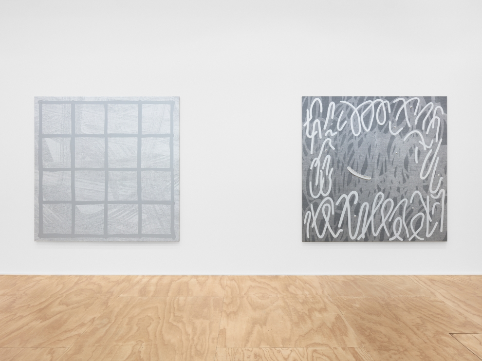 Installation view of two Amy Feldman paintings