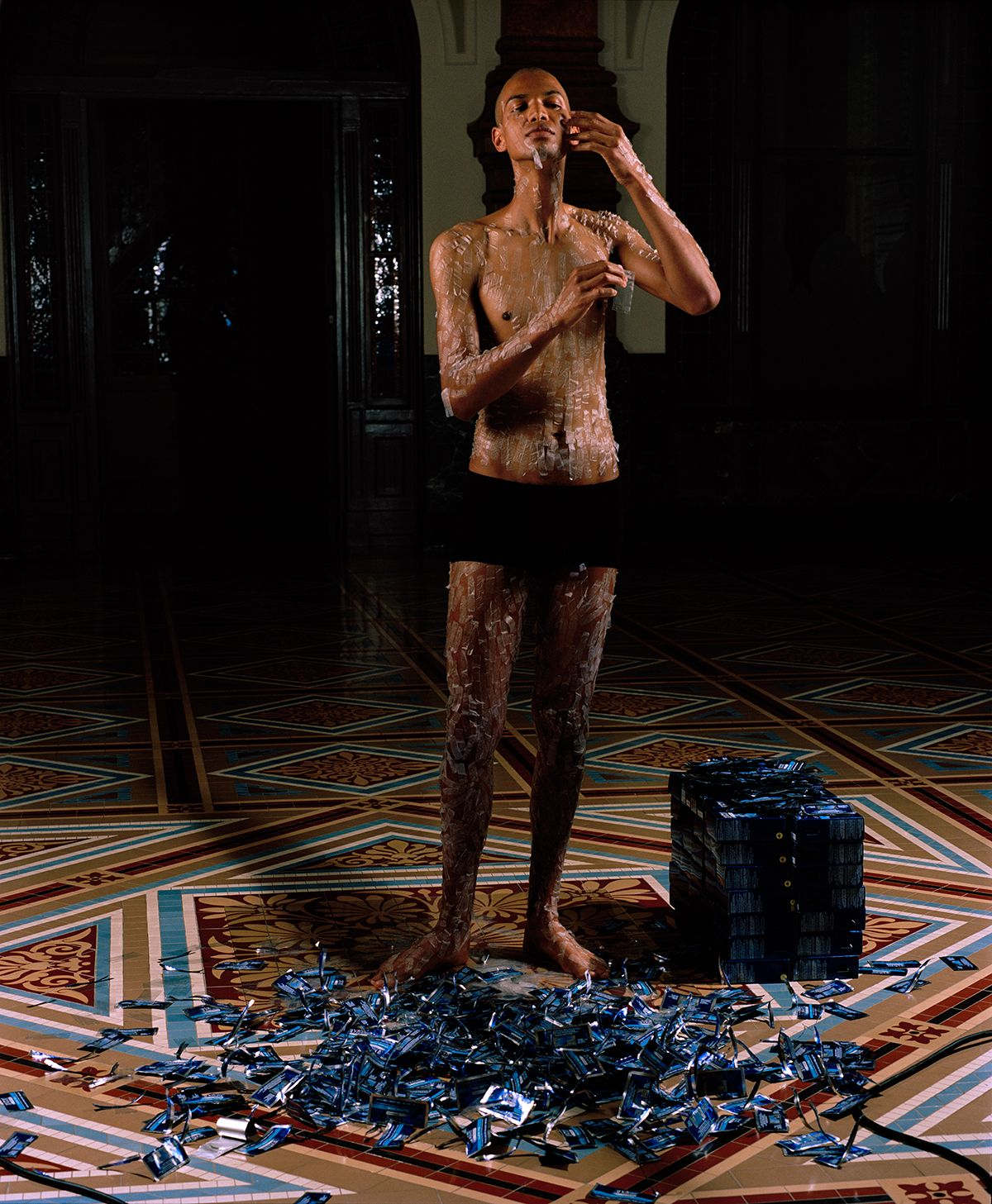 WILMER WILSON IV_Portrait with Hydrogen Peroxide Strips Performance: National Portrait Gallery, Washington, DC, 2016.
