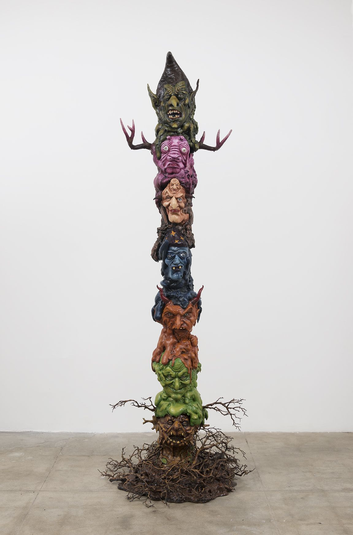 Witch Totem, 2016, Halloween masks, glass eyes, expanding foam, magi-sculpt, polyurethane horns, polyurethane branches, resin, acrylic paint, metal base, wooden pole