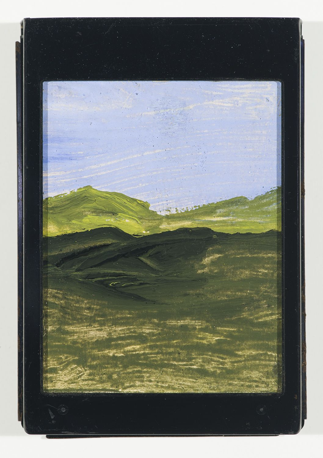 Frank Walter, Landscape, Green Hills, watercolor and oil on polaroid box cover w/ metal cartridge, 5 1/4 x 3 3/4 inches