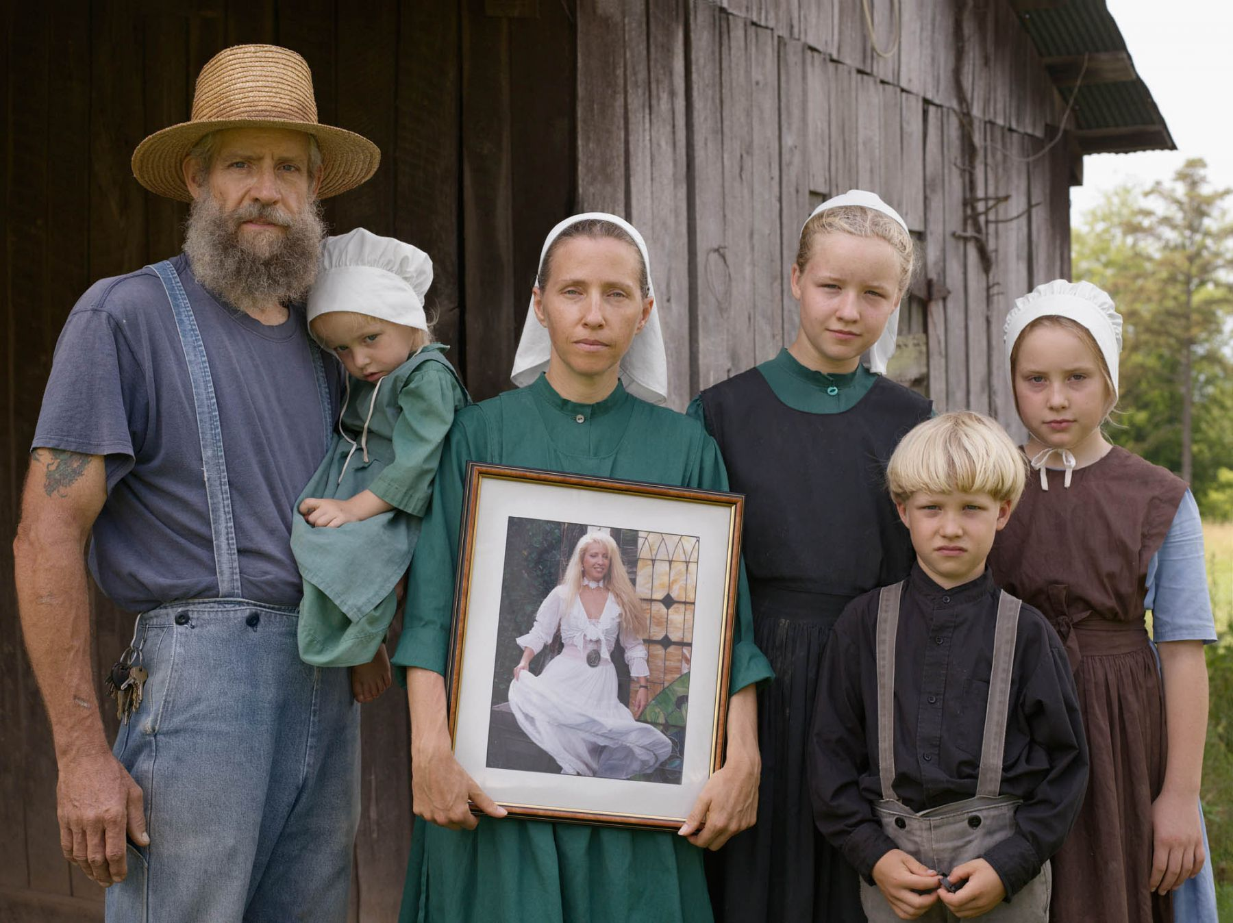 LUCAS FOGLIA, Family Portrait with the Photograph George Took of Christina Before They Were Married, Tennessee, 2008