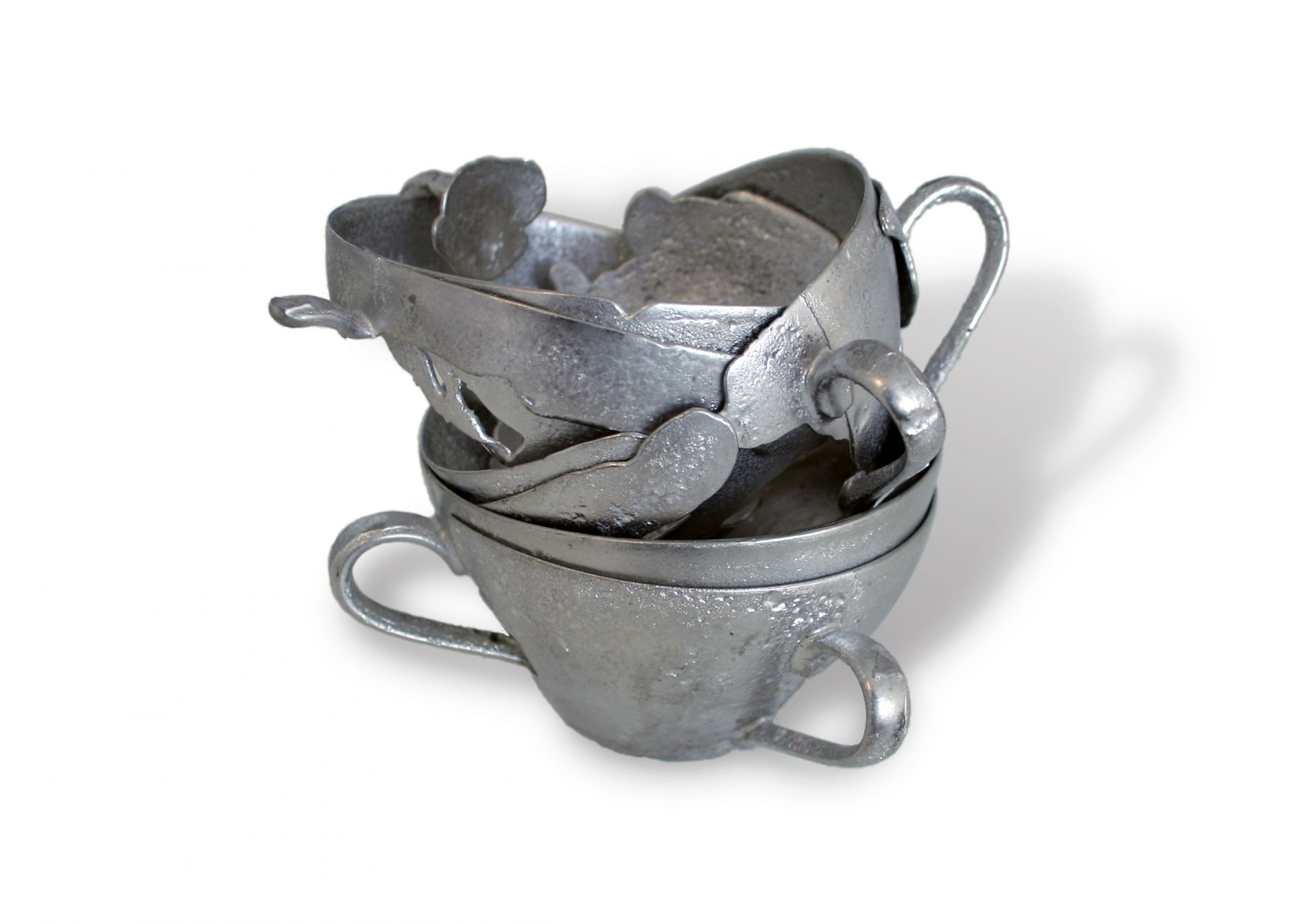 David Clarke, teacup, pewter, lead, silver, smithing