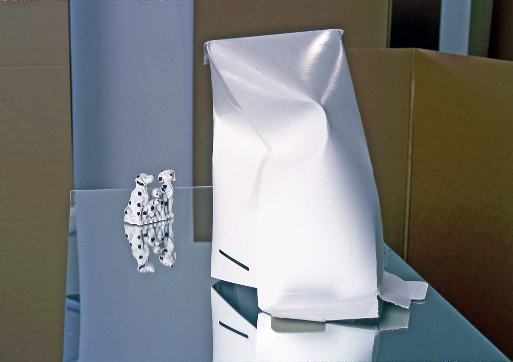 Untitled, 2001, Mirror pedestal, Dalmatians, gallery envelope, and artist tape, 54 x 32 x 18 inches