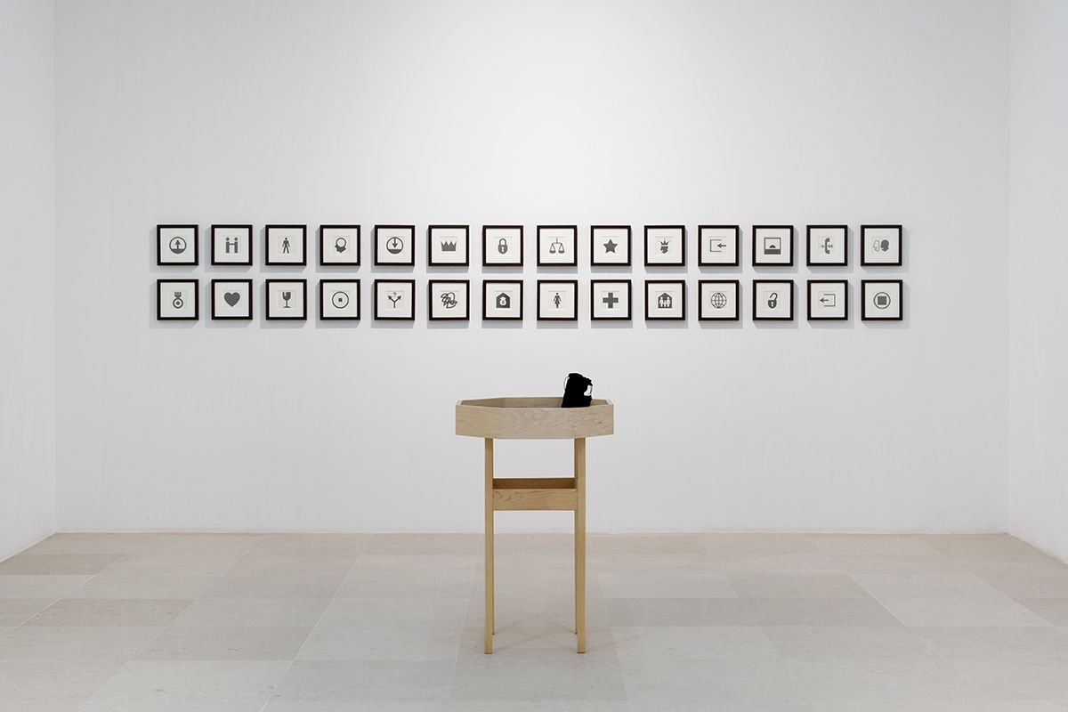 Allan McCollum & Matt Mullican, YOUR FATE, 2004, 28 framed graphite drawings, one table with felt inserts, booklet, dice, Table: 25 x 25 x 37 1/4 inches (66 x 66 x 94.6 cm), Paper: 8 x 8 (20.3 x 20.3 cm) each, Frame: 9 1/8 x 9 1/8 inches (23.2 x 23.2 cm) each