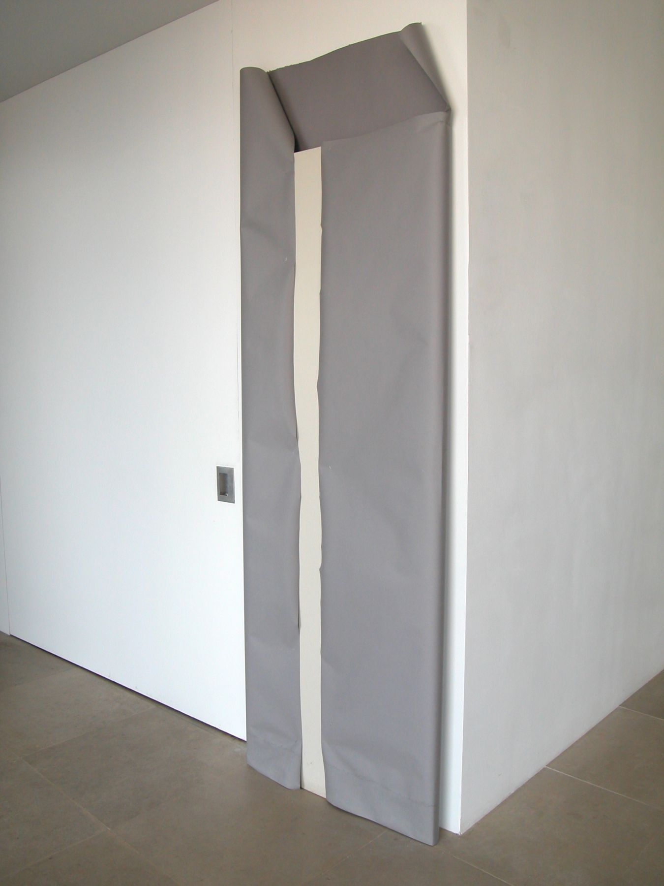 The Is Should Be Capitalized, 2008, Hollow core door, paper, staples, 90 x 30.5 x 3 inches