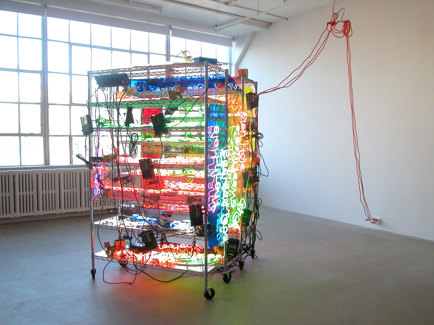 Jason Rhoades, Shelf (Love Pocket), 2003 (detail), Seville Ultra Durable chrome shelving system with 17 shelves, 23 neon panels, 41 ceramic donkey carts, 3 power strips, 3 orange extension cables, 14 metal hooks, 83 x 54 x 24 inches