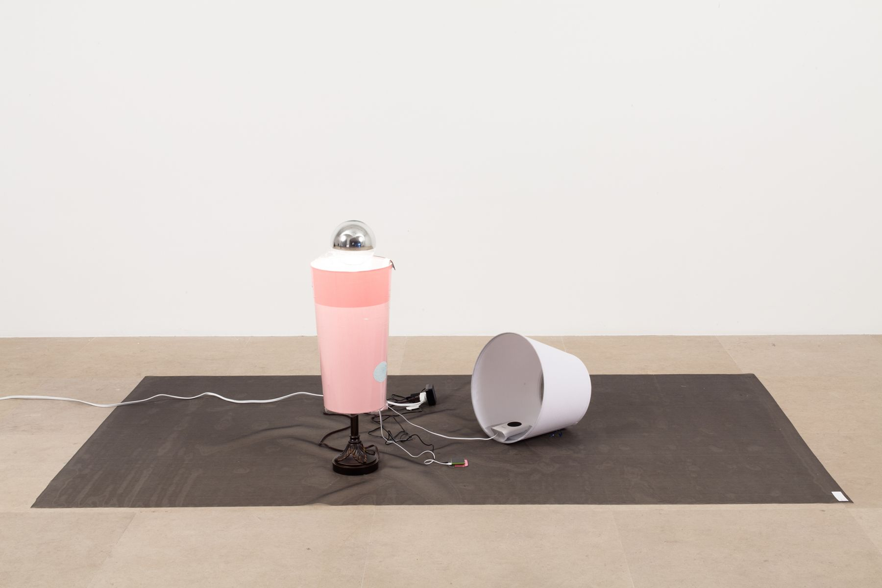 Josef Strau, Exercises, 2012, Poster, 2 lamps, sound on iPod, 2 speakers, dvd with 19 slides, and wire mesh, dimensions variable