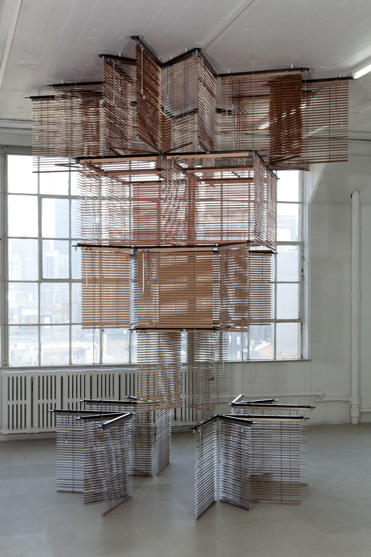 Haegue Yang Tower on String - Seated in New York, 2012 Aluminum Venetian blinds, powder-coated aluminum frame 137 x 120 x 120 inches (348 x 304.8 x 304.8 cm)