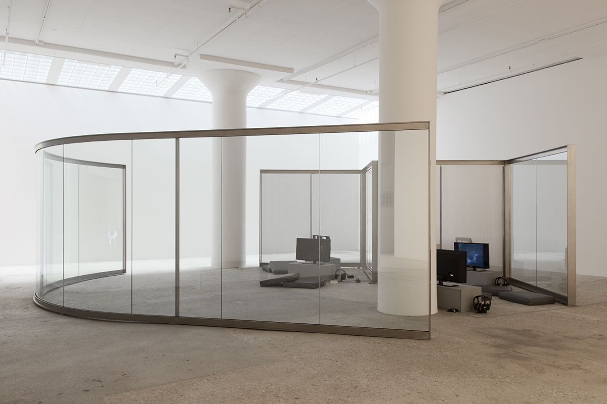 Design for Showing Rock Videos, 2014  Reflective glass, stainless steel  93 x 227 x 28 [Anchor] 3 inches  Installation view, Greene Naftali, New York, 2014
