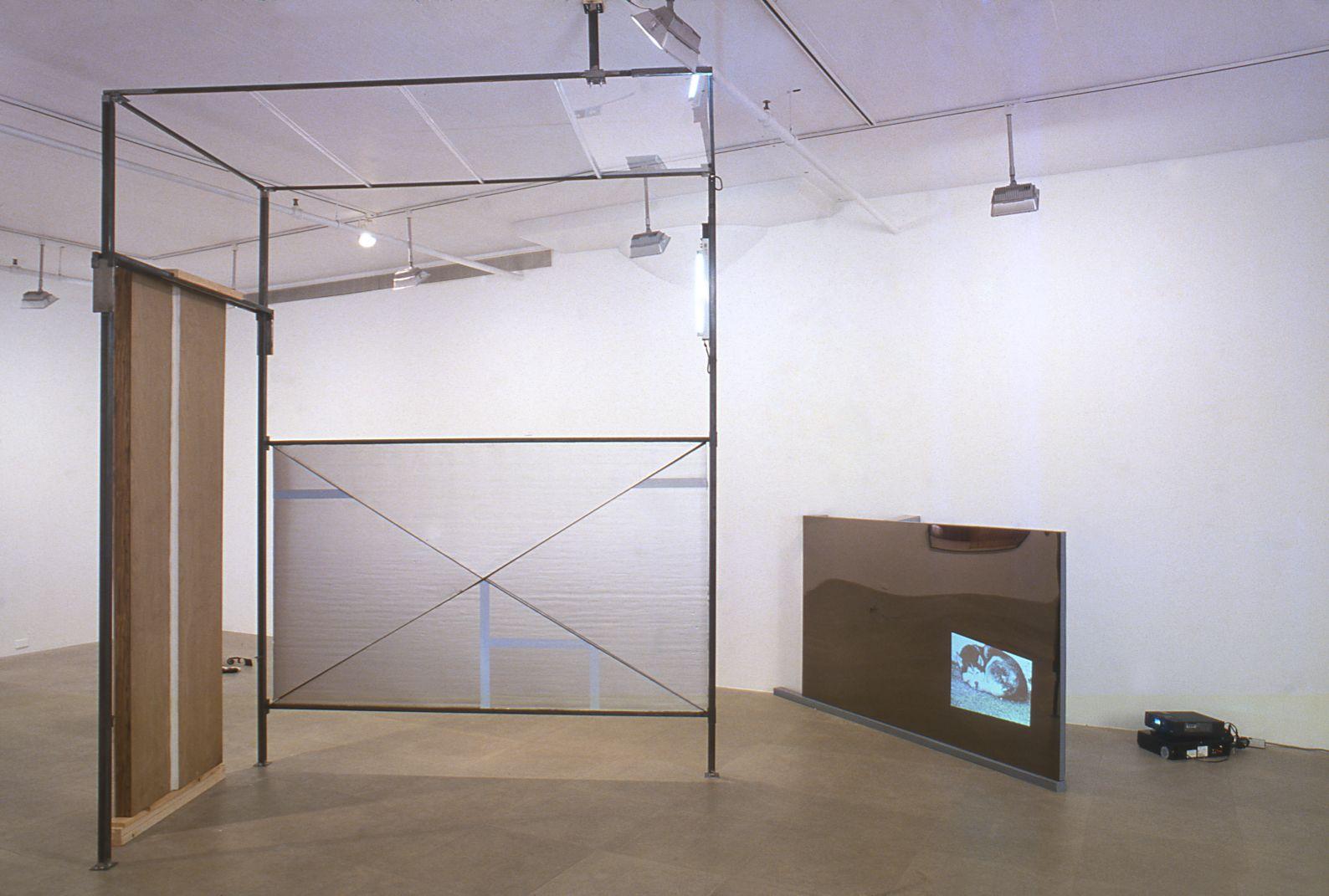Heidie Gianotti, When Suburban Living Was Good, 2001, Steel, plexi, insulation, caulking, vinyl, super 8 film, Dimensions variable