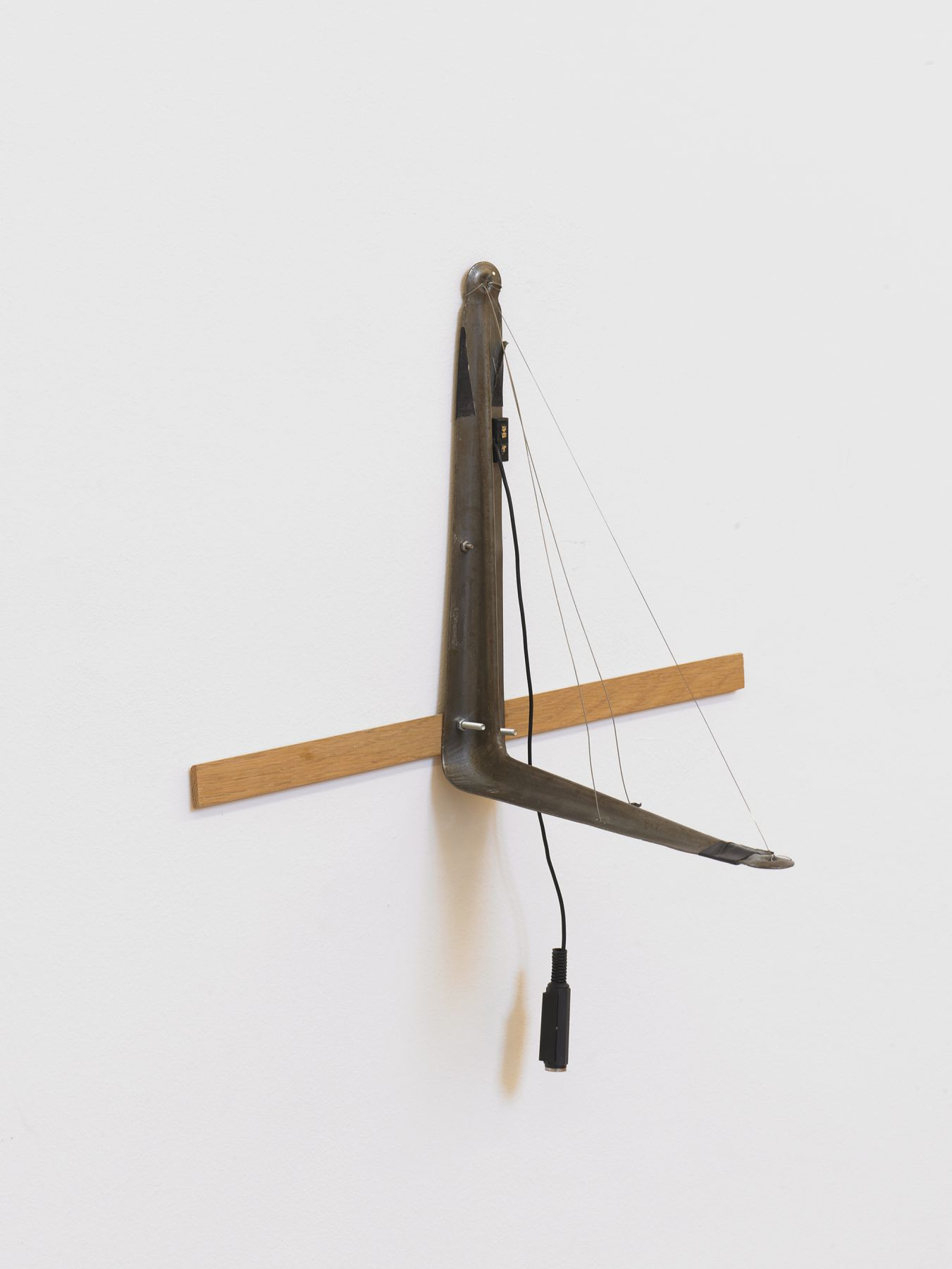 Tony Conrad L-bracket with Three Strings, 2002 Bowed wire (hand stretched), L-bracket, electric pickup 13. 3/4 x 15 3/4 x 10 1/4 inches 35 x 40 x 26 cm