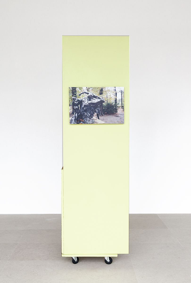 Rachel Harrison, The Fourth Shade, 2000, Wood, polystyrene, cement, acrylic, cardboard, hollow core door, lamp, wheels, and chromogenic print, 85 x 32 x 24 inches