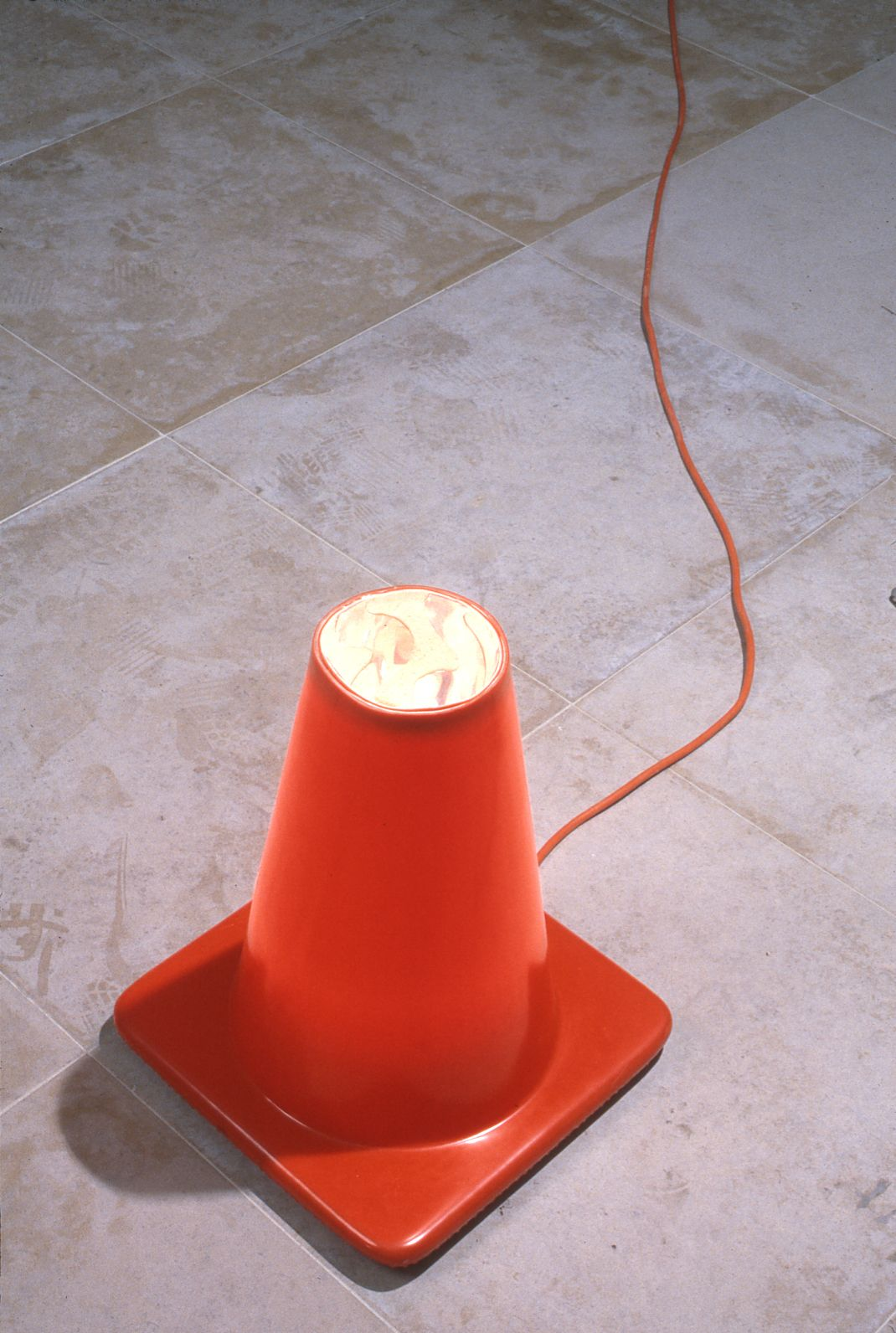 Jeff Nelson, Point, 1995 traffic cone, mylar, light source, extension cord Dimensions variable
