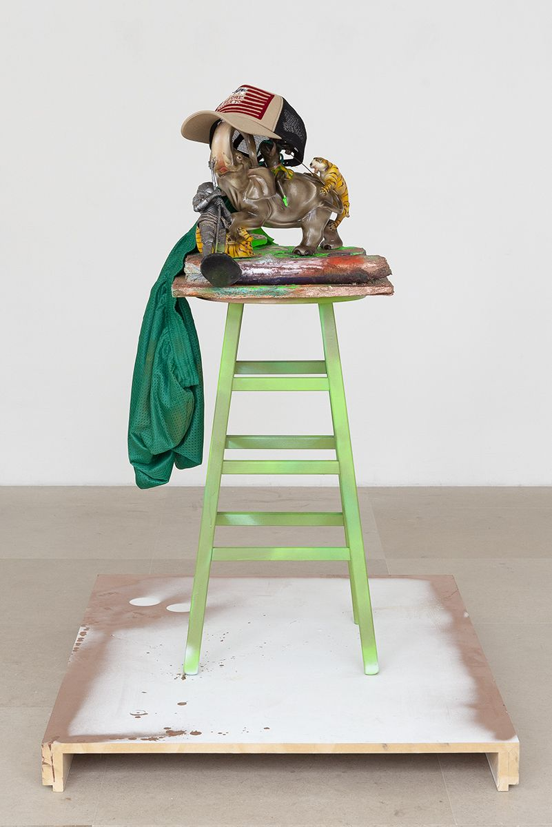 Rachel Harrison Before You Have To, 2018 Wood, cement, polystyrene, acrylic, enamel, glass, figurines, mesh shorts, hat, log, and stool 46 x 26 3/8 x 38 inches (116.8 x 67 x 96.5 cm)