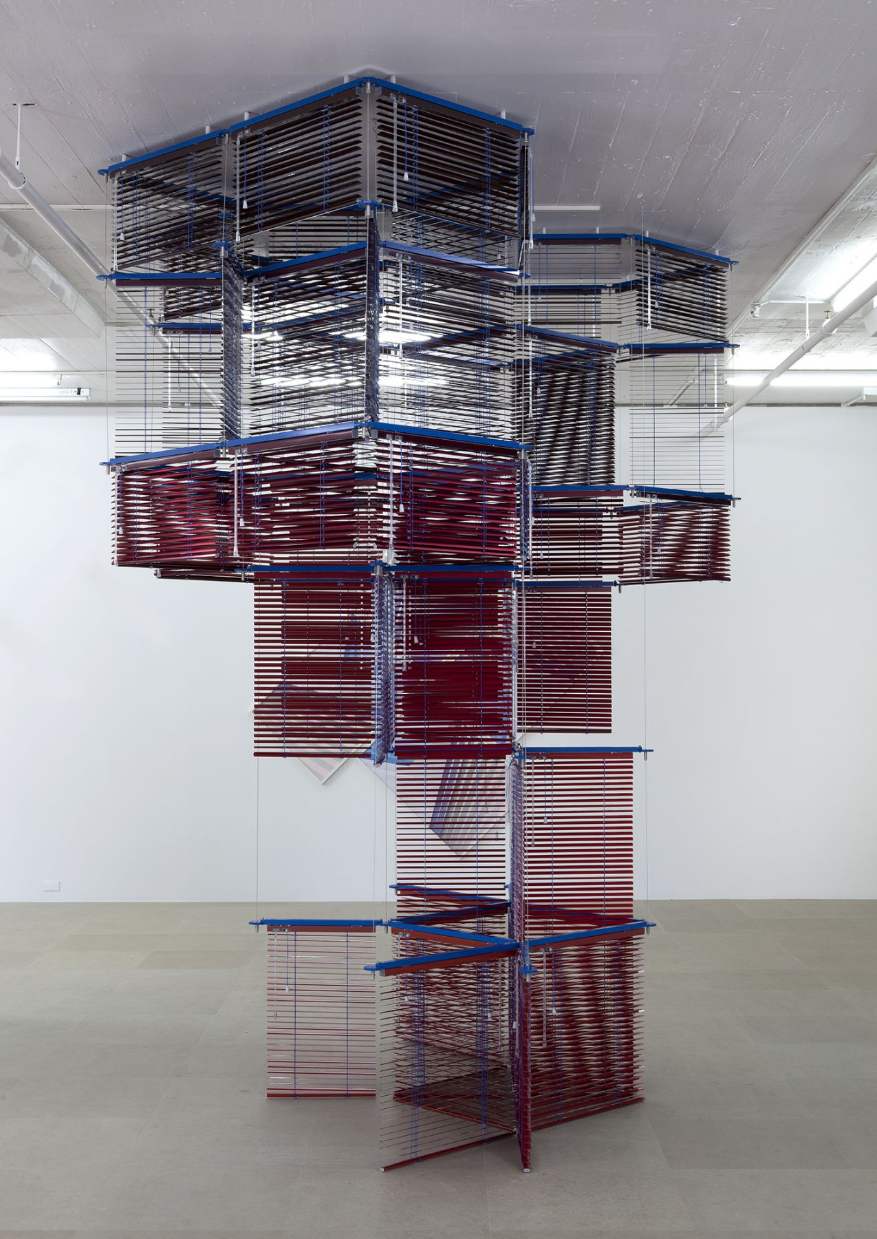 Haegue Yang Tower on String - Facing New York, 2012 Aluminum Venetian blinds, powder-coated aluminum frame 137 x 120 x 100 inches (348 x 304.8 x 254 cm)