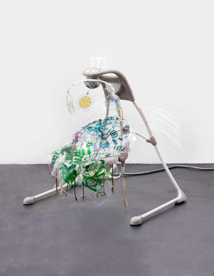 Katja Novitskova Ingenuity Inlighten Cradling, 2015 Electronic baby swing, polyurethane resin, stock image of protein molecule, fishing baits, cable hose 43 3/8 x 35 3/8 x 35 3/8 inches (110.2 x 89.9 x 89.9 cm)