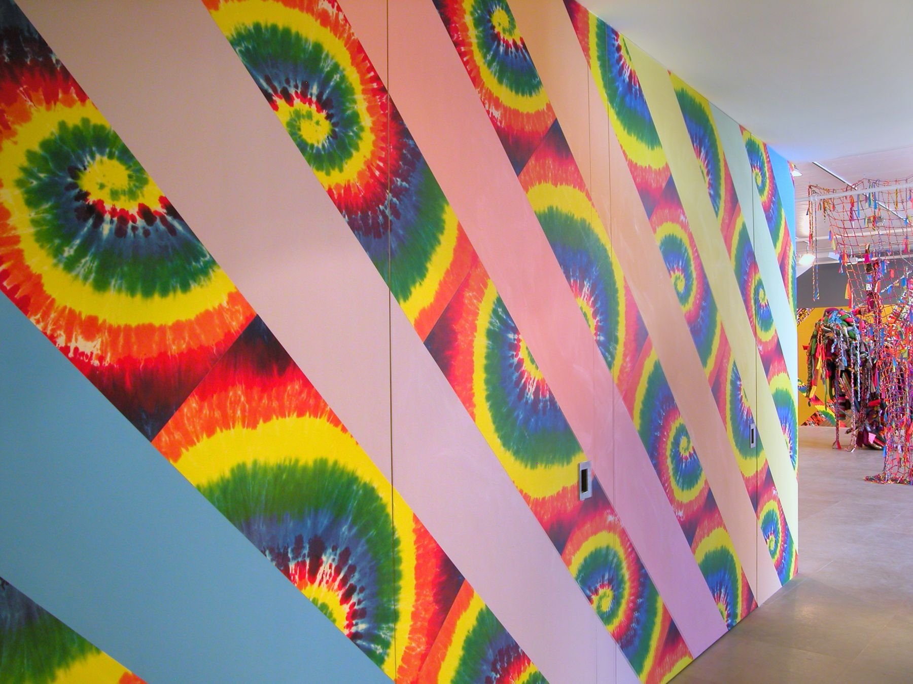 Jim Drain, I Would Gnaw on My Hand (Hallway), 2007, tie-dye and leopard print wallpaper, latex paint, Dimensions variable, Installation view, Greene Naftali, New York, 2007